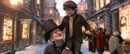 Scrooge (JIM CARREY) left, TINY TIM (Gary Oldman), right