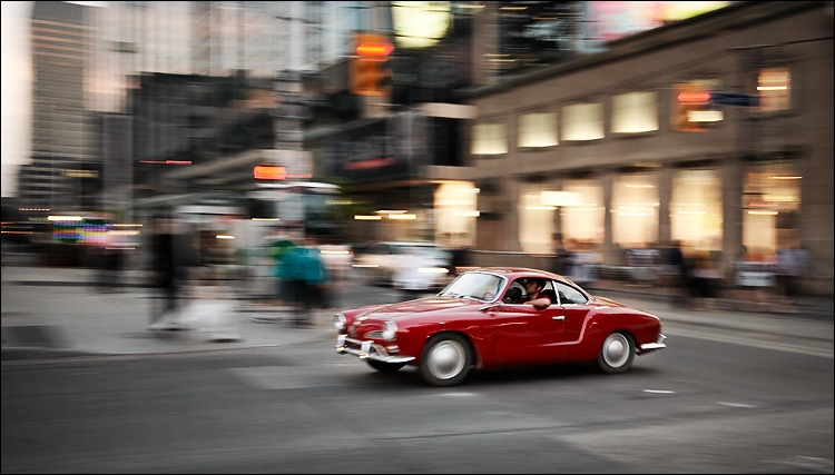 panning_red_2-seater_car_yonge-dundas.jpg